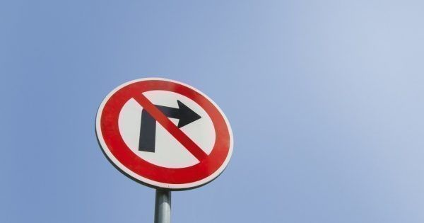 Low angle view of no right turn sign against clear sky